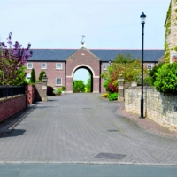 New Hall Court, Northfields, Bickerton Courtyard with large Arch leading to fields