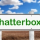 Chatterbox signpost. Green letters on a white signboard pointing right